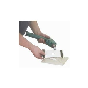 Outil de découpe pour oeillet et tétière